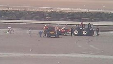 The rescue operation is carried out near Rhyl harbour wall. Picture: RNLI