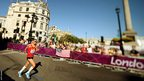Frederic van den Heede of Belgium runs past Trafalgar Square during the T46 men's marathon