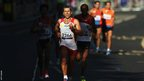 Men&#039;s T12 marathon winner Alberto Laso Suarez of Spain leads a group of runners