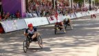 David Weir of Great Britain crosses the finishing line in his fourth Paralympics 2012 victory to win the T54 Men&#039;s Marathon