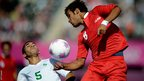 Marcos Yuri Cabral Da Costa of Brazil and Ehsan Gholamhosseinpour Bousheh of the Islamic Republic of Iran battle for the ball