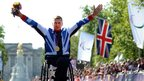 Great Britain&#039;s David Weir celebrates after collecting his gold medal for winning the men&#039;s marathon T54 race