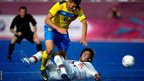 Ivan Shkvarlo of Ukraine is challenged by Viacheslav Larionov of Russian during the men&#039;s football 7-a-side gold medal match