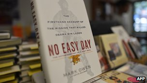 "Copies of a book by former Navy SEAL titled ""No Easy Day"" are seen on display at a bookstore in Washington, DC"