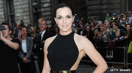 Cyclist Victoria Pendleton wearing a black dress and posing for the camera