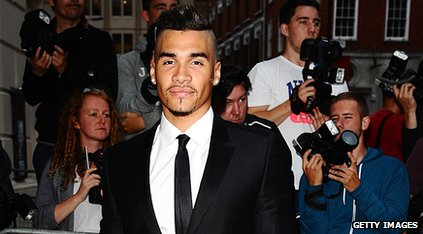 Gymnast Louis Smith wearing a suit and posing for cameras
