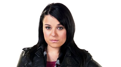Actress Dani Harmer wearing a black jacket and looking at the camera