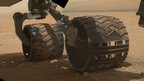 Curiosity's wheels on Mars.