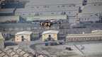 A helicopter carrying journalists flies over the prison compound - 10 September