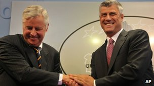 Kosovo Prime Minister Hashim Thaci, (r) handshakes with International Civilian Representative, Pieter Feith