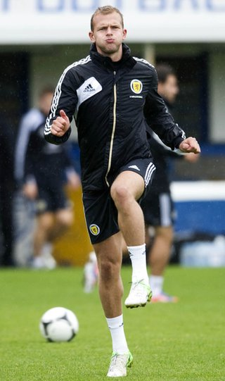 Jordan Rhodes works hard in training ahead of the match against Macedonia