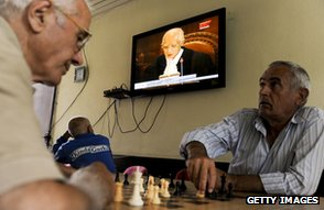 Men play chess and watch TV, Pristina, 2010