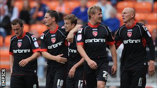 Morecambe players celebrate a goal in the Capital One Cup victory at Blackpool in August