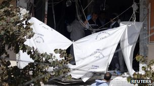 Forensic officers work at the scene of a bomb blast in Istanbul