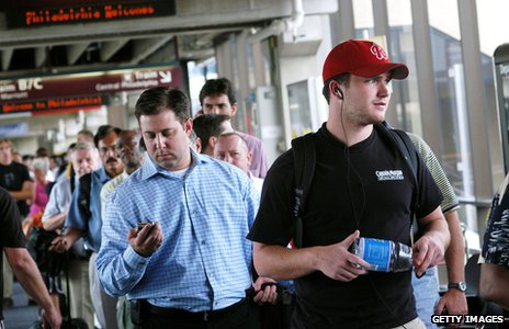 Airport passengers holding bottled water
