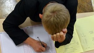 Pupil sitting exam (library)