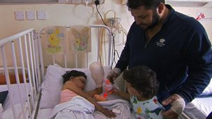 Abu Abdul Malik with his daughters in hospital