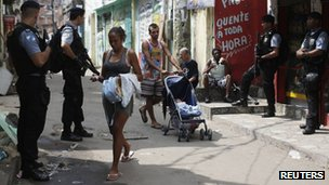 Police patrolling the streets of the Vila Cruzeiro favela in August 2012