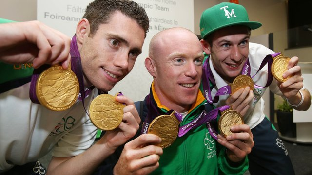 Paralympic champions Jason Smyth, Mark Rohan and Michael McKillop show off their gold medals
