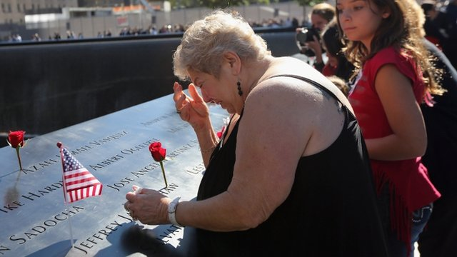 A woman becomes emotional at the 9/11 memorial in lower Manhattan on Tuesday