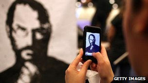 Person takes photo of Steve Jobs portrait