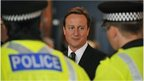 David Cameron and police officers
