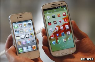 iPhone and Galaxy S3 being held