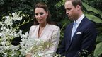 The Duke and Duchess of Cambridge pause as they view an orchid named in honour of Diana, Princess of Wales, at Singapore's Botanical Gardens on day one of their Diamond Jubilee tour