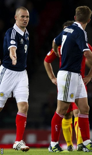 Miller and Morrison celebrate after Scotland's equaliser at Hampden Park