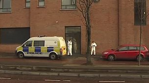 Forensics officers at scene of balcony death