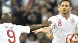 Frank Lampard (right) celebrates with Jermain Defoe