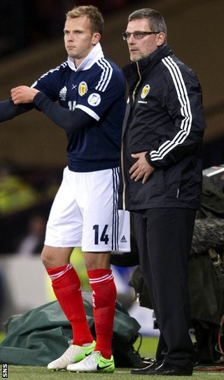Rhodes comes on as a substitute during the second half at Hampden