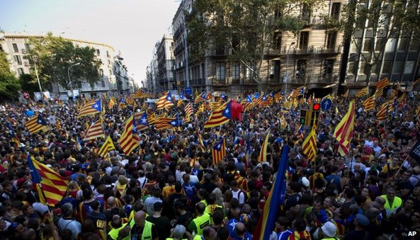 Demonstrators wave Catalan flags during a protest rally in Barcelona , Spain, 11 Sept 2012