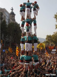 "A group of Castellers form a human tower called a ""Castell"" during a demonstration on Catalan National Day in Barcelona, September 11, 2012."