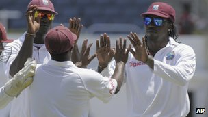 "this image released by DigicelCricket.com, West Indies"" Chris Gayle, right, celebrates with teammates at the end of the second inning on the third day of a second cricket Test match against New Zealand in Kingston, Jamaica, Saturday, Aug. 4, 2012. ("