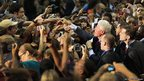 Former US President Bill Clinton greets people after speaking during a campaign stop at Florida International University