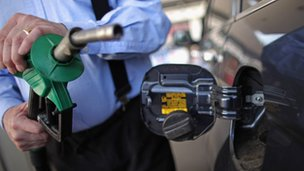 Motorist holding petrol pump