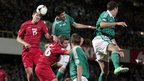 Luxembourg's Ante Bukvic and Chris Philipps defend as Kyle Lafferty and Jonny Evans of Northern Ireland press for a goal