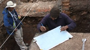Mathew Morris (left) and colleague record the grave
