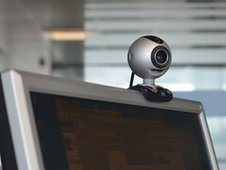 This photo shows a webcam on top of a computer at an office in London on June 1, 2011