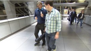 Shaun Buswell approaches a musician on the Underground