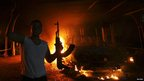 Man with gun next to burning US consulate in Benghazi