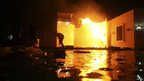 Man ducking and running from flames at US consulate in Benghazi