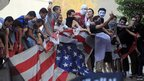 Protesters tear up the US flag in Cairo
