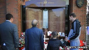 Members of the public pay their respects at the Liverpool Hillsborough memorial