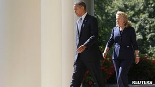 US President Barack Obama walks with Secretary of State Hillary Clinton to deliver remarks following the death of the US Ambassador to Libya 12 September 2012