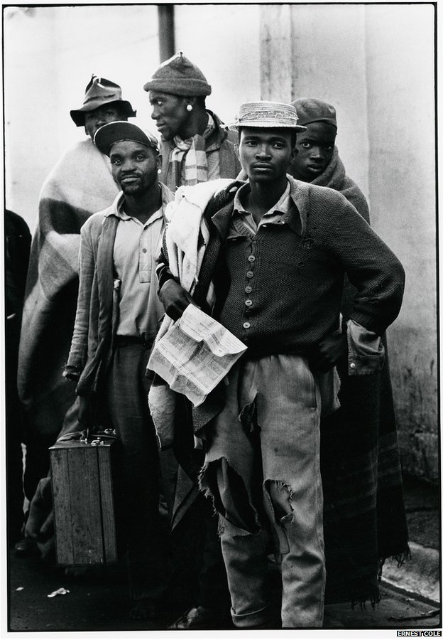 Pensive tribesmen, newly recruited to mine labour, awaiting processing and assignment by Ernest Cole