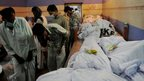 Relatives identify loved ones in a Karachi morgue
