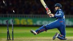 England's batsman Craig Kieswetter is bowled out