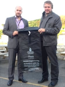 Left to right: Independent councillor Andrew Wallis and cabinet member Steve Double with the new bin sack